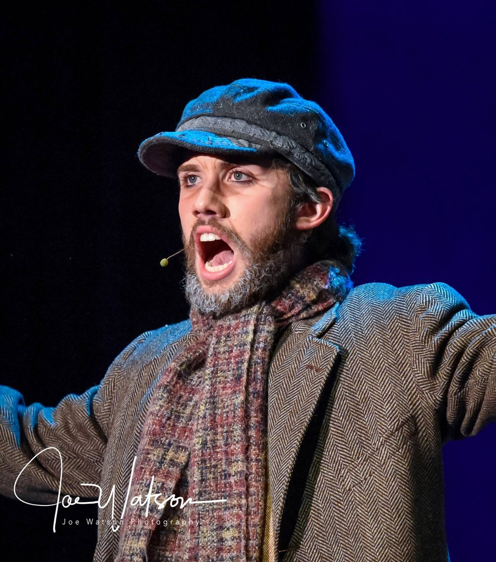 (Photo by Joe Watson) Seth Jones singing during a production of Fiddler on the Roof