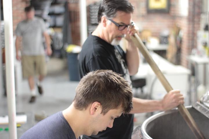 Scott stirring the the grain during mashing in.