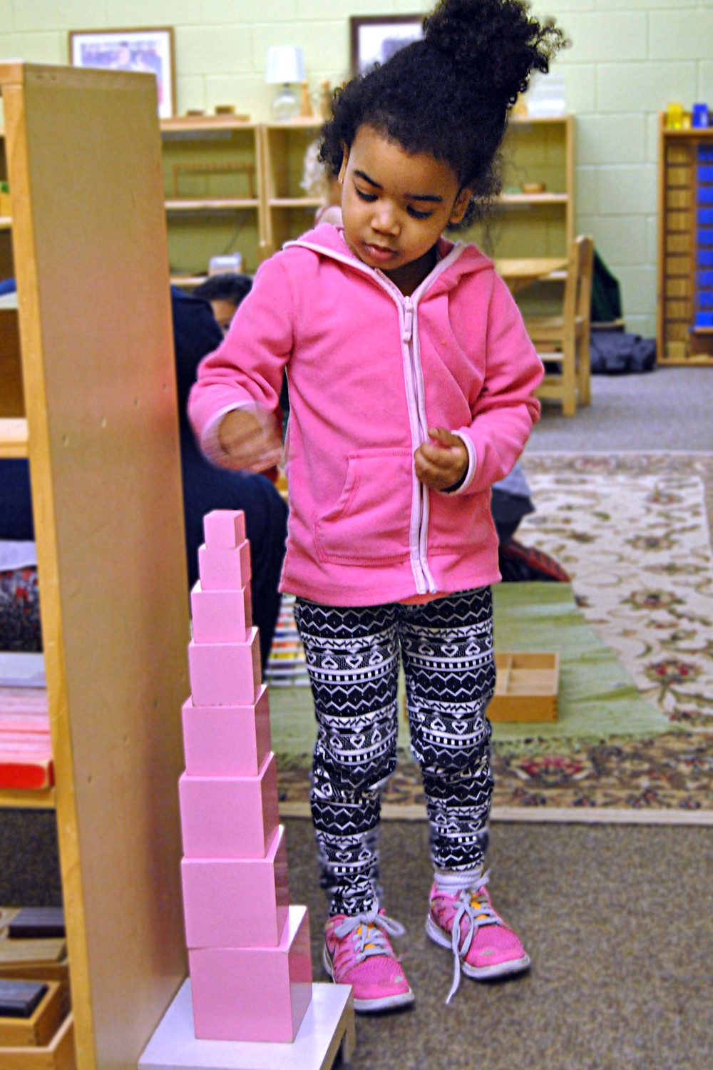 The pink tower helps children accomplish skills