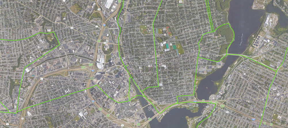 Protected bike lanes (green) running through Providence would have the potential to transform the city, connecting the East Bay Bike Path, the Woonasquatucket River Greenway, and the Blackstone River Bikeway across college hill.