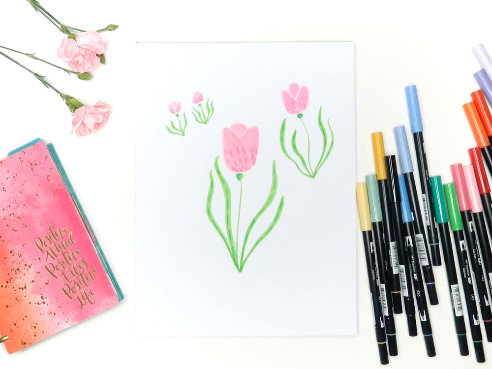 6 easy flowers to draw with tombow markers brown paper bunny studio i then use an even darker shade of both pink and green to add some simple lines as detail watch the video below to see it all come together mightylinksfo