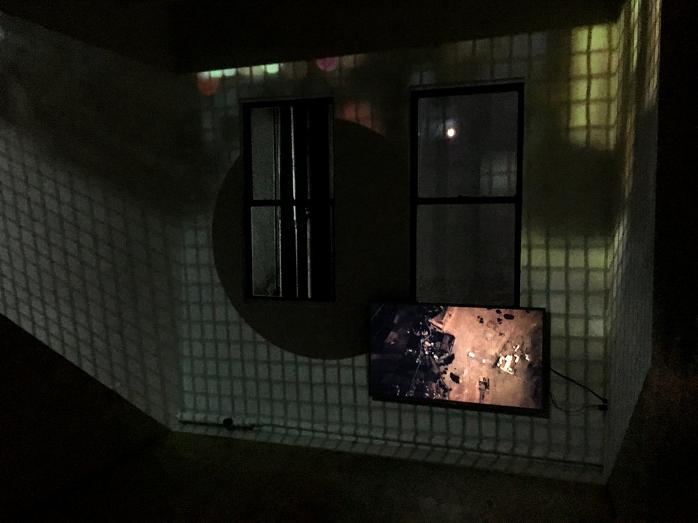 Quincunx: The Flag   Two channel video, 18 minutes, install shot at  Inset , Lubov Gallery, NYC, 2018  An essay video set within a single city block. In the channel projected into the room, the narrator paces the perimeter of the block as darkness falls, while on screen she meditates in two languages on collecting things and looking with the eyes of a child.