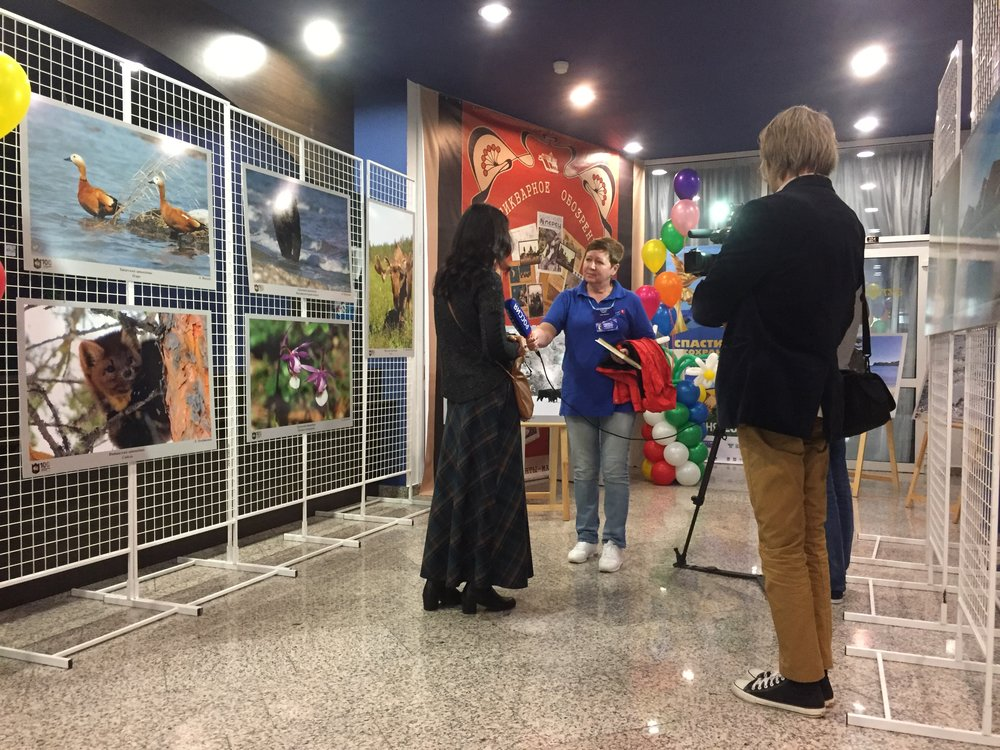 Oxcana is interviewed by sponsoring tv station while Dennis from Estonia watches.