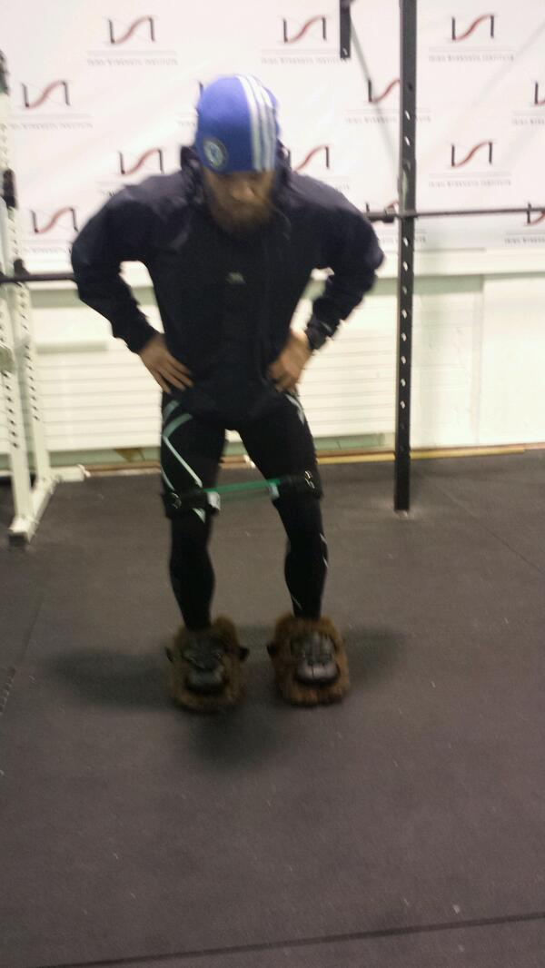 UFC featherweight sensation Conor McGregor continues his rehabilitation from ACL surgery. In early February he posted a pic of himself engaged in a component of his rehab regimen. There are three things that I notice in this photo. 1. Most obvious is that he is standing on an unstable surface. 2. He appears to be squatting. 3. The green band around his lower thighs. This is a complex, but excellent exercise that addresses the goals of strength and balance after ACL surgery. The unstable surface requires that Conor maintain his balance, while simultaneously he is performing a squat. No easy feat to be sure. However, the added component of the green band makes this exercise even better. The band provides resistance to the hip abductor muscles- the ones on the outside of the hip. These muscles function to move the leg outward. The hip abductor muscles are critically important in controlling valgus (inward) stress on the knee. Undue valgus stress on the knee during jumping and landing could re-injure the ACL. It appears that Conor is progressing well with his rehab. He injured his knee in his last fight at UFC Fight Night 26 on August 17, 2013