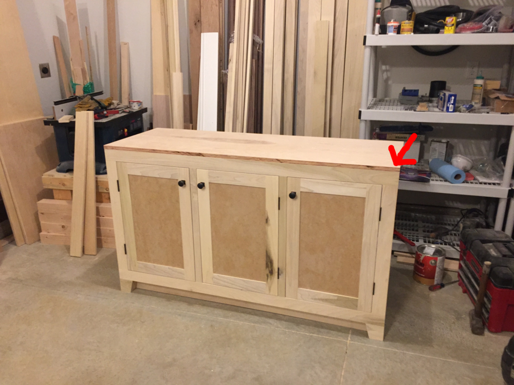 I have attached the top to the cabinet and it is now ready for a 1in strip poplar lip.