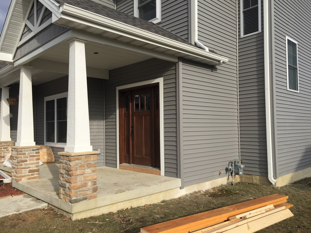 The front entryway and porch siding and trim