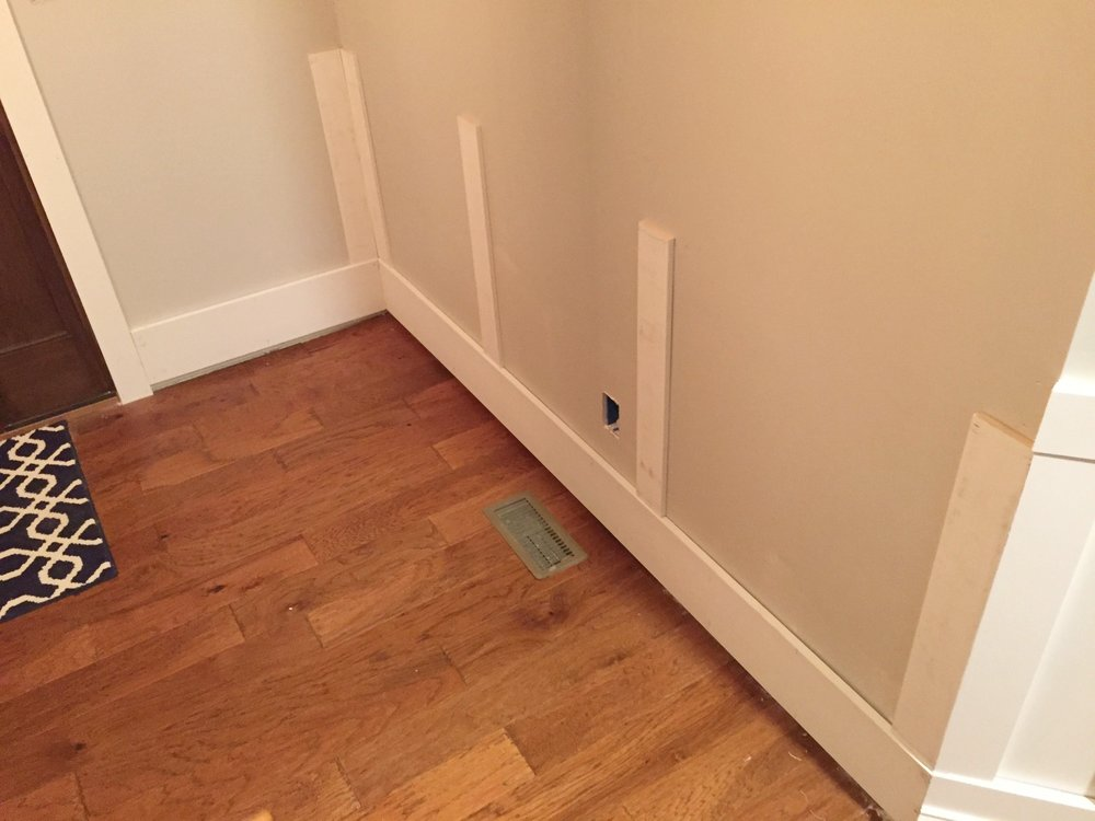 Installing baseboards and wainscoting in front entryway