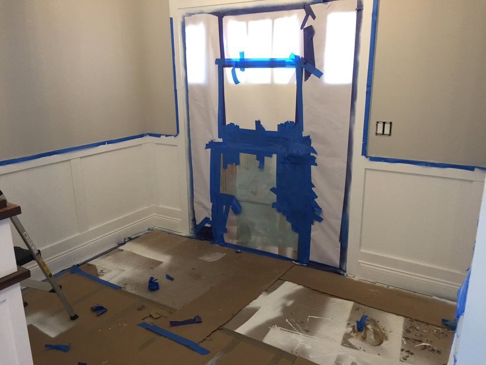 Applied painters tap and painting the wainscoating white