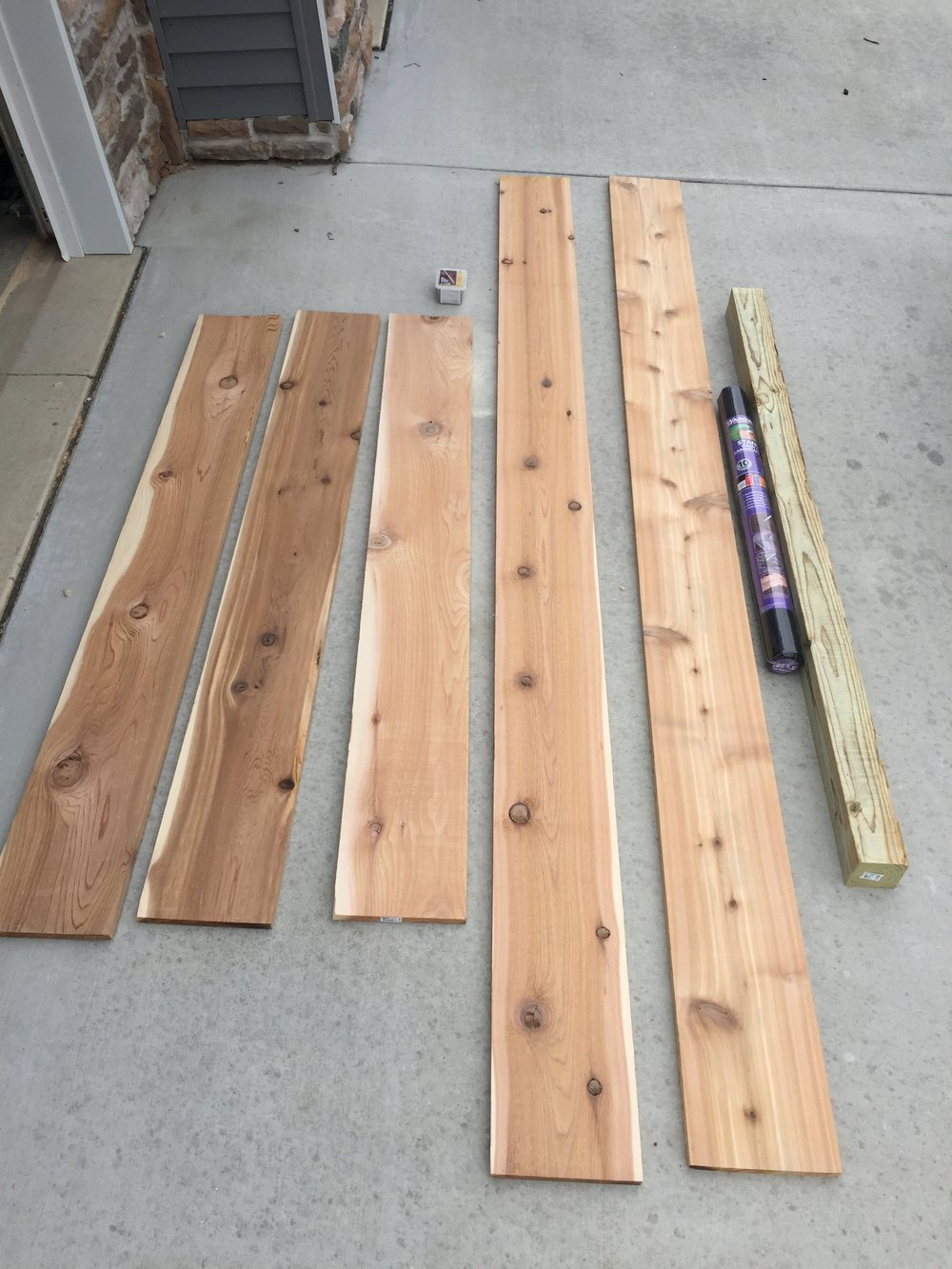 Cedar boards, screws, weed fabric