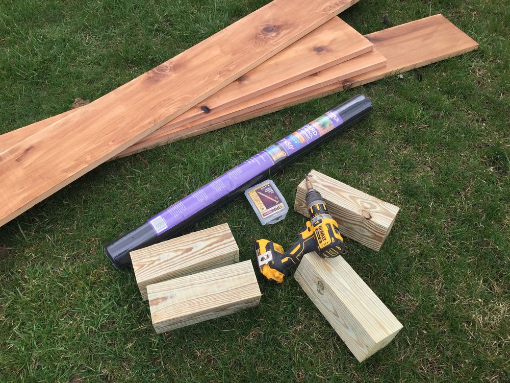 Prepped materials for installation of the cedar garden box