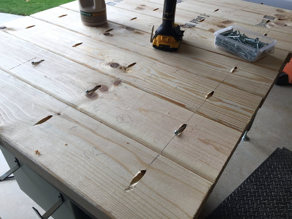 Screwing In The Kreg Jig Screws Into The Bottom Of The Farmhouse Table Top