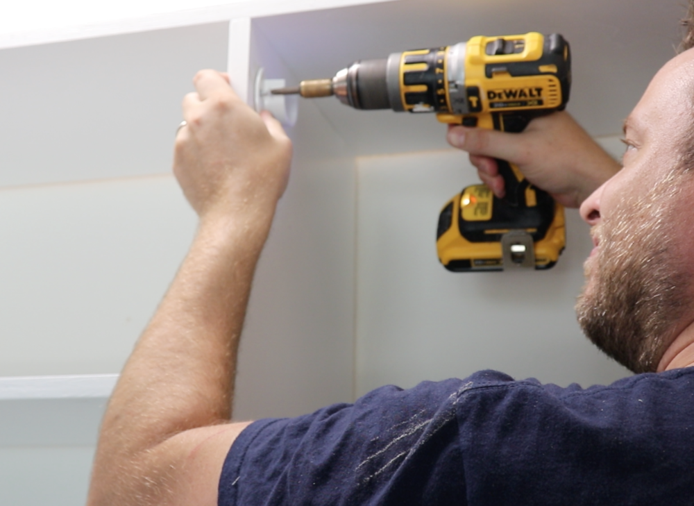 Installing White Hanging Hardware in a closet using a Dewalt Drill