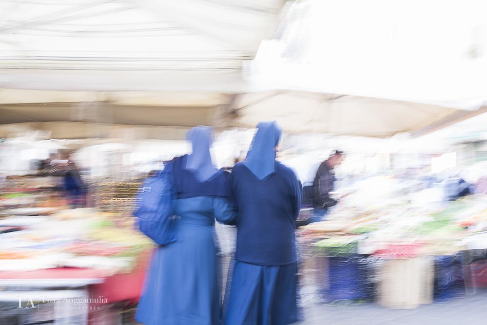 Nuns strolling in Campo de Fiori market.