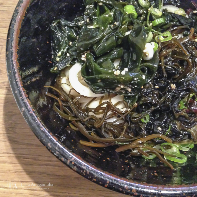 Cold udon noodles with mixed seaweed and cold sauce.