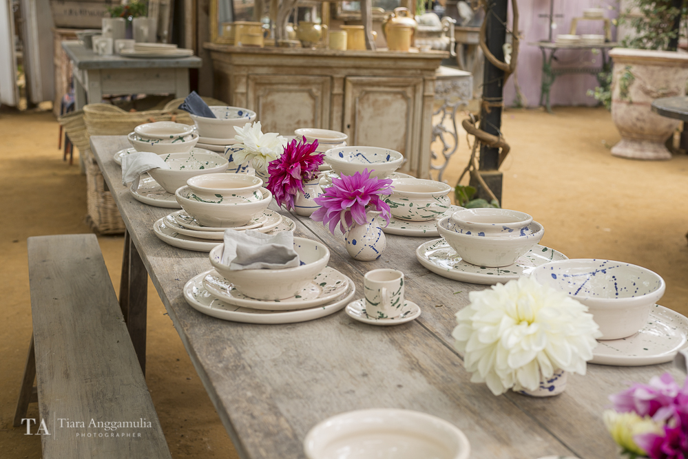 Dining table with Italian tablewares inside Petersham Nurseries shop.