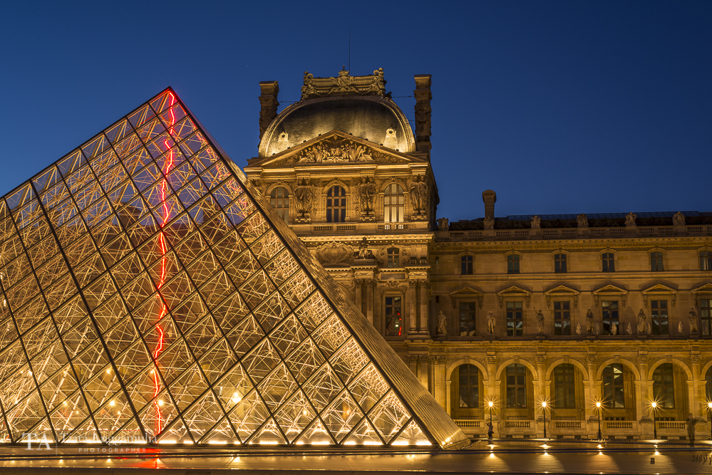 The pyramid entrance to the Louvre Museum.