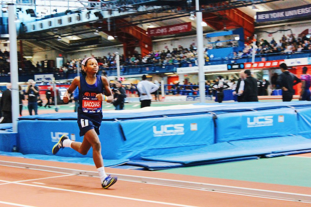 Xion Bacchas taking the win of the Rising NYRR Girls' 800M race in 2:34:83.