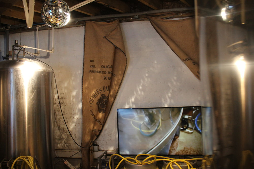 brewing - A commission for BOS 2018 & Brockley Brewery. Installation in brewery - video made during the brewing process, rotating mirror ball and bottled beer.