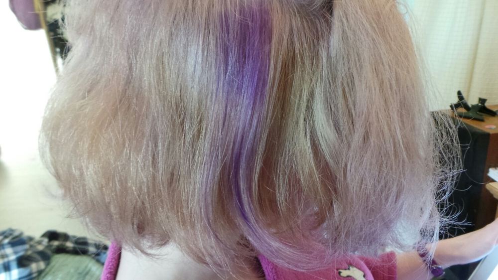 The purple streak was an undiluted application of the purple dye to make sure it worked.