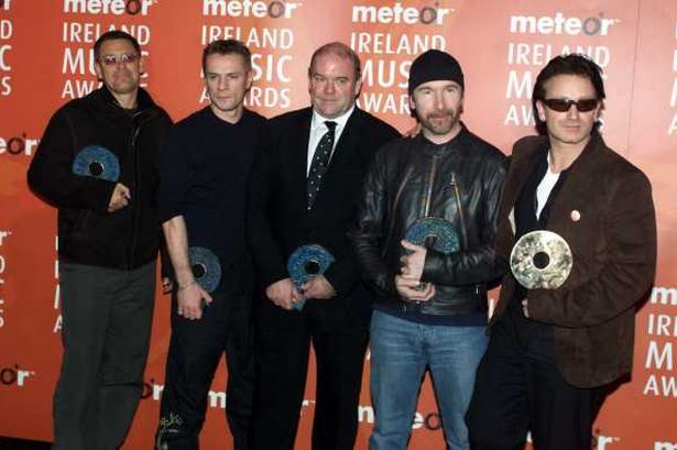 U2 with manager Paul Mc Guinness. Click for Paul's Wikipedia page to learn more.