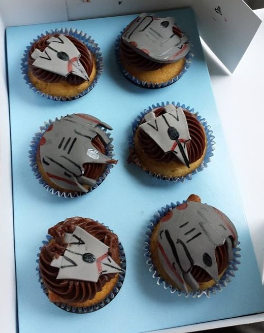 Claire's anniversary present to me with my game's spaceships on them! That's what support looks like. If you're wondering, support tastes like cupcakes.