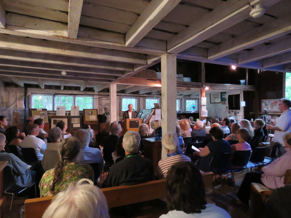 The barn is packed with poets and poetry lovers