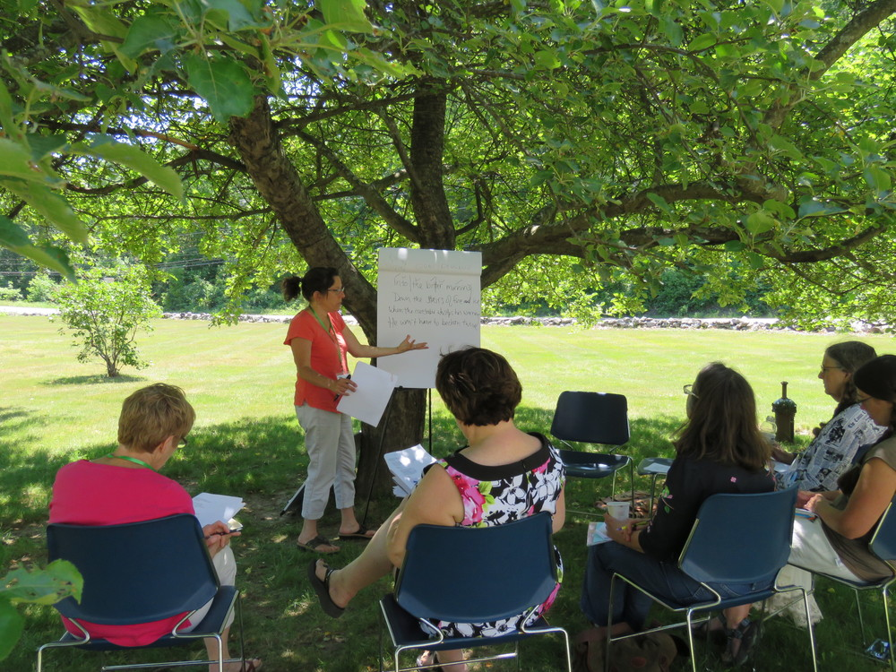 Midge Goldberg teaches under the apple tree