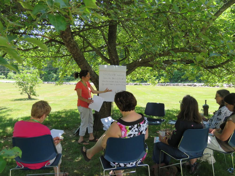 Midge Goldberg teaches under the apple tree