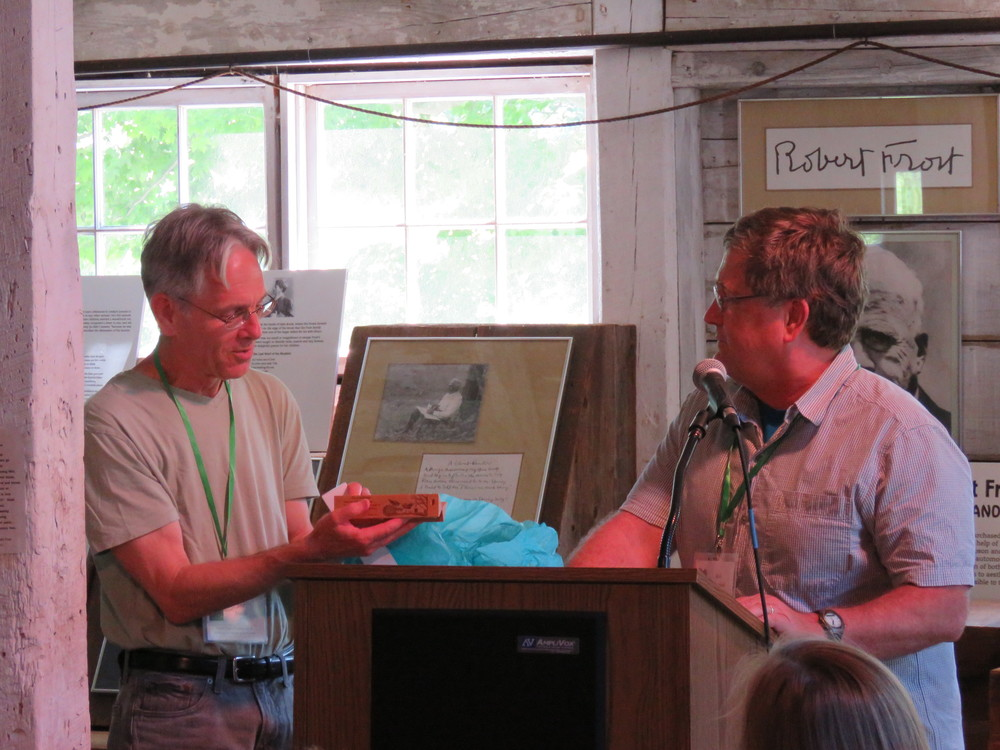 Bob Crawford presents Tim Steele with a gift made from Frost's maple tree