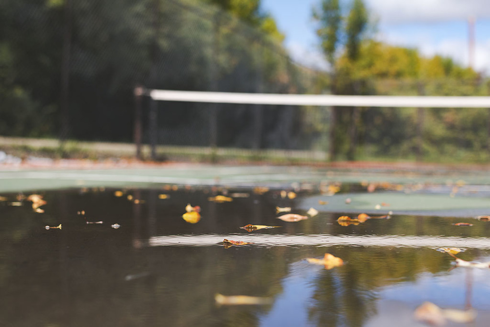 Leaves floating on the tennis court after a recent rainfall at Lumsden Beach, Saskatchewan.