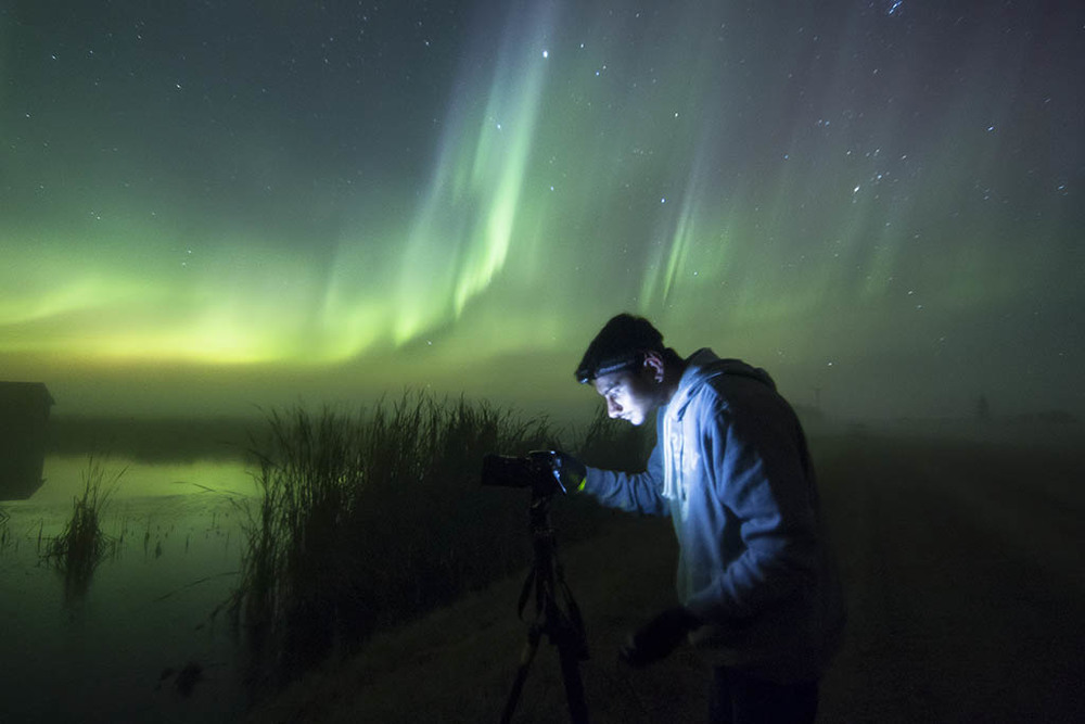 Herry adjusts his settings to compensate for the changes in exposure during a solar storm. |  Canon 70D 11mm f/2.8 ISO2000 10s