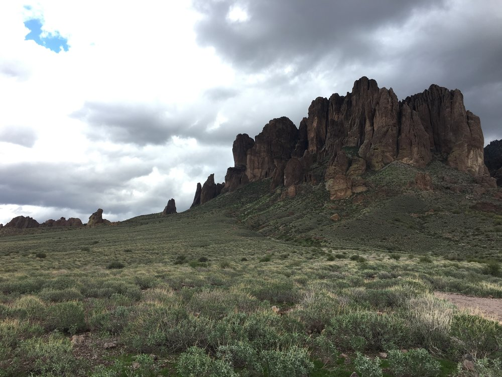 Trail starts off pretty gentle, but your ultimate destination is up those enormous rocky outcrops.