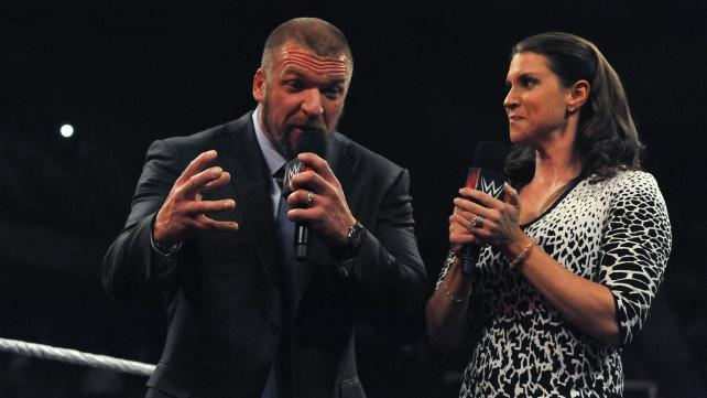 Triple H and Stephanie hamming it up as ironic, vicious people who hate the fans and their staff.