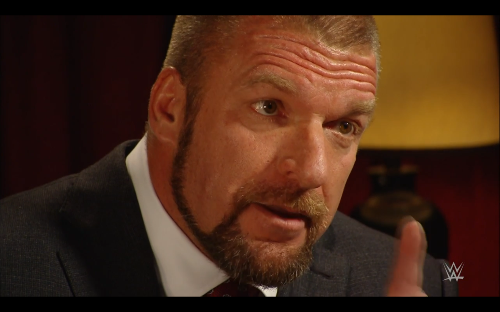 Triple H in a sit down interview with Michael Cole, remaining in a consistent character who believes in sports competition.