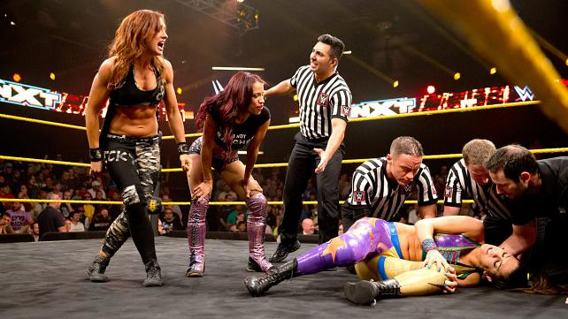 Becky Lynch and Sasha Banks hurt Bayley and gang up on her.