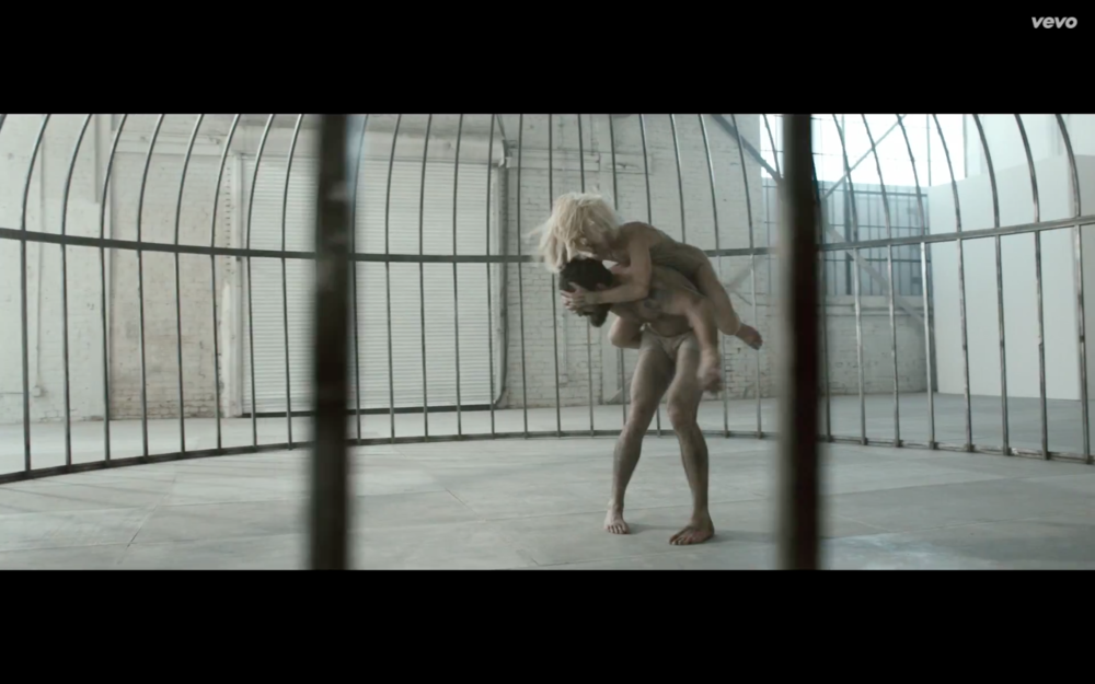 Shia Labeouf and Maddie Ziegler engaged in battle in Elastic Heart.