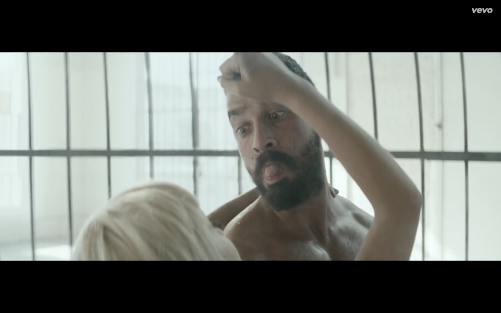 One of the most touching moments in the video, Maddie gains control of Shia, transforming him into a loving, playful father.