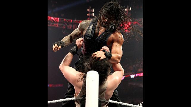 Roman Reigns pummeling Luke Harper.