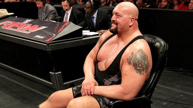 The Big Show watches Roman fighting Harper.