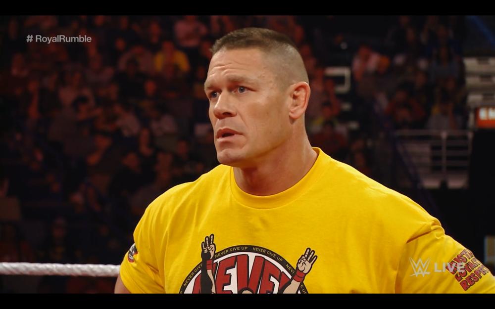 A sad John Cena chastised by Seth Rollins.