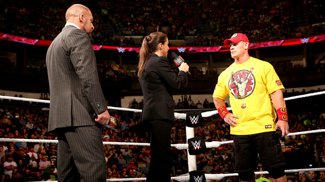 John Cena is confronted by The Authority.