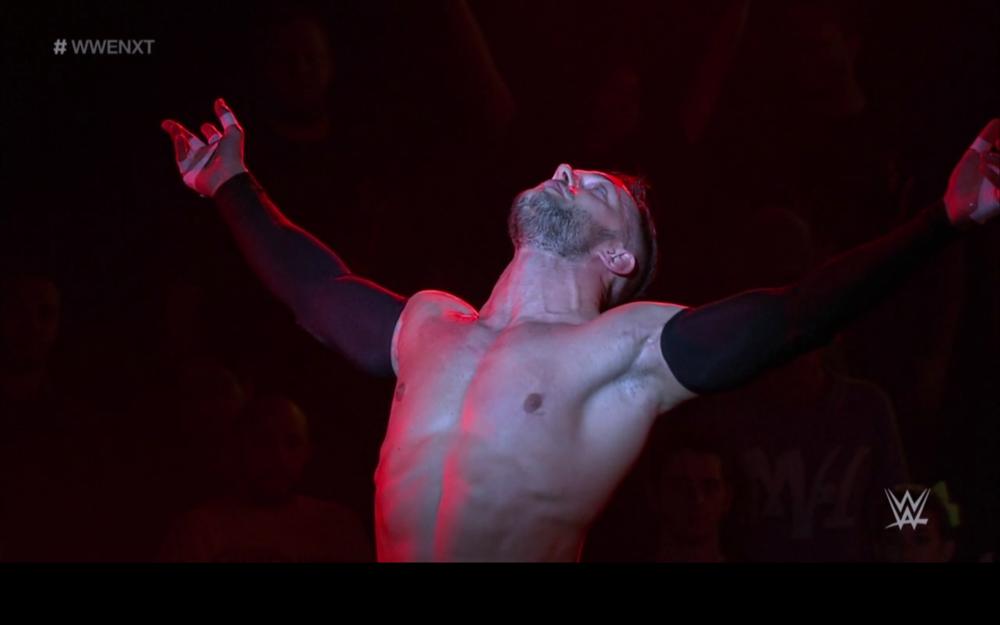 Finn Balor enters the NXT theater.
