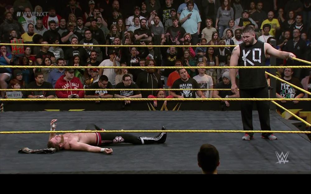 Kevin Owens destroys a victoriousSami Zayn.