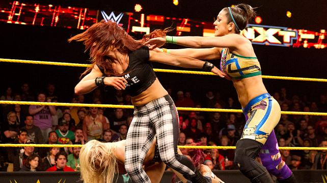 Bayley saves the day, attacking Becky Lynch and Sasha Banks.