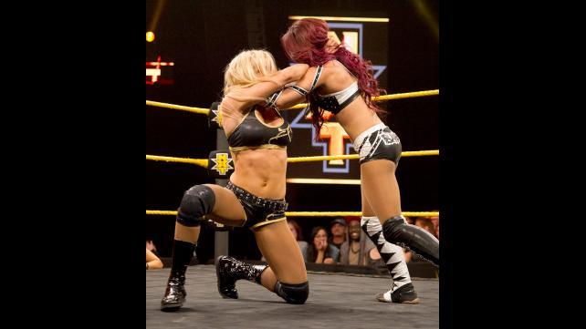 Sasha Banks and Ms. Charlotte lock-up.