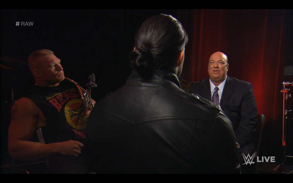 Paul Heyman conducts an interview between Roman Reigns and Brock Lesnar.