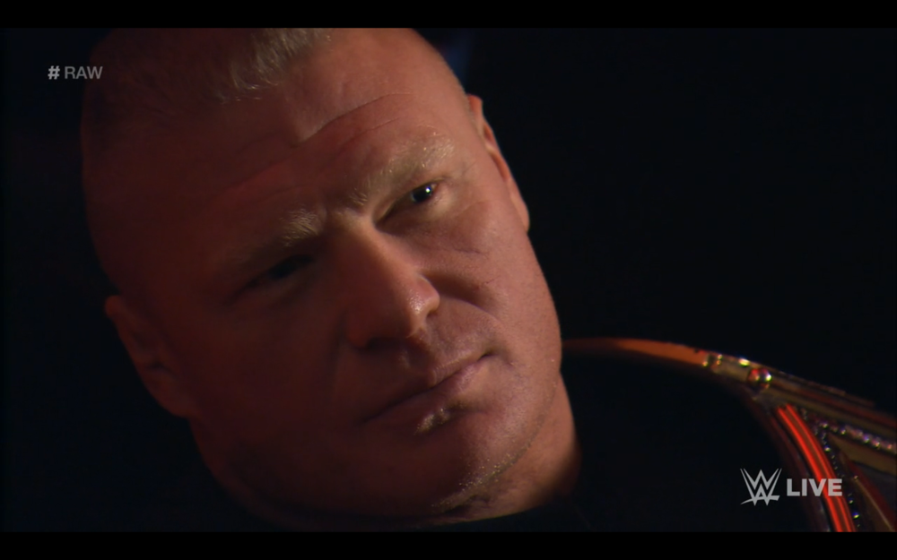 Brock Lesnar, WWE Heavyweight Champion of the World, stares down Roman Reigns.