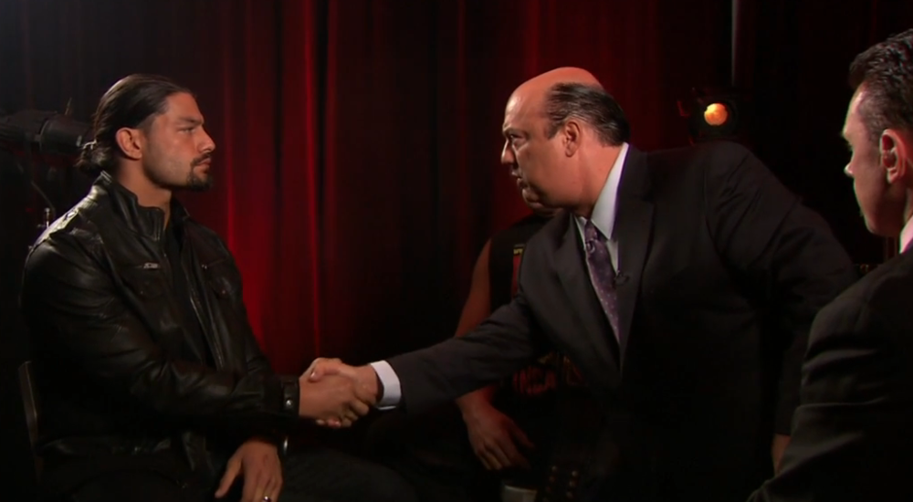 Paul Heyman shakes Roman's hand at the beginning of the interview. The segment ends with Lesnar shaking Roman's hand.