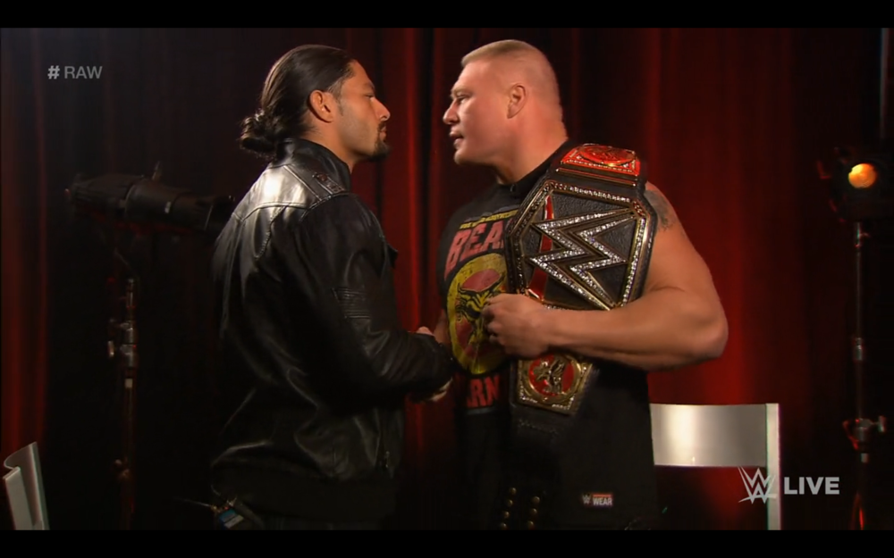 Roman Reigns shakes Brock Lesnar's hand.