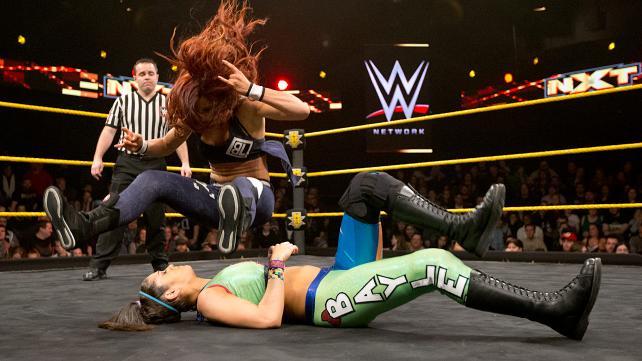 Becky Lynch performs her rocker leg drop.